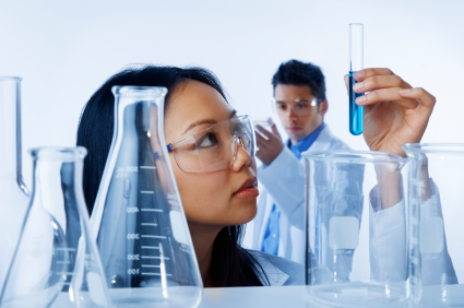 Scientist Looking at Vial