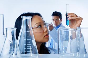 Scientist Looking at Vial
